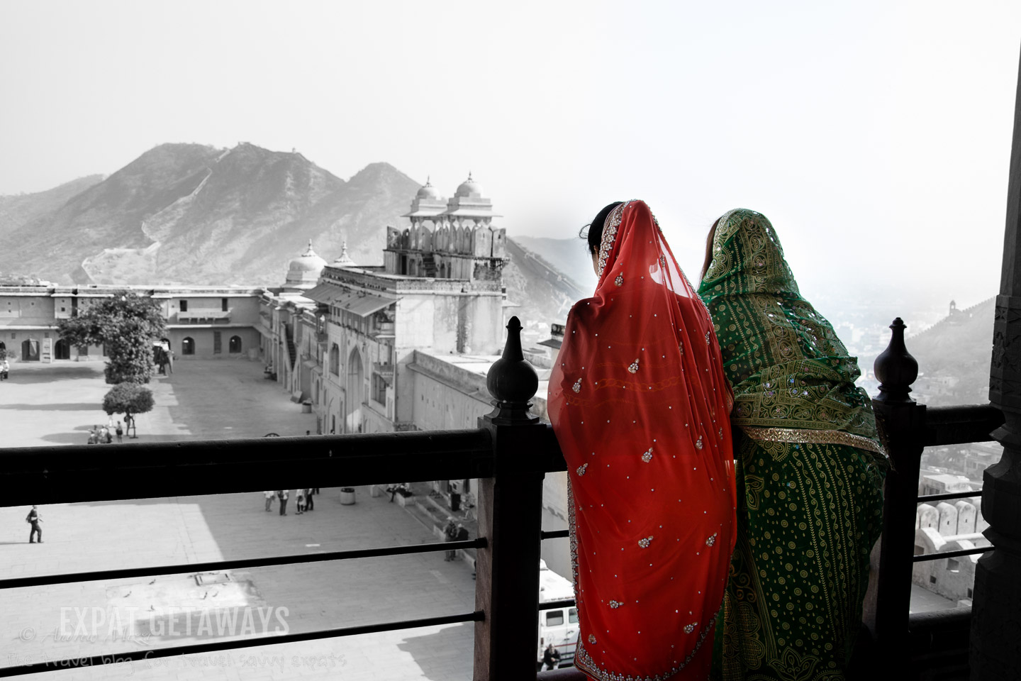 Women in Indian saris enjoying the view from the Amber Fort, Jaipur. Expat Getaways, 5 Nights Golden Triangle, Delhi, Jaipur & Agra, India.