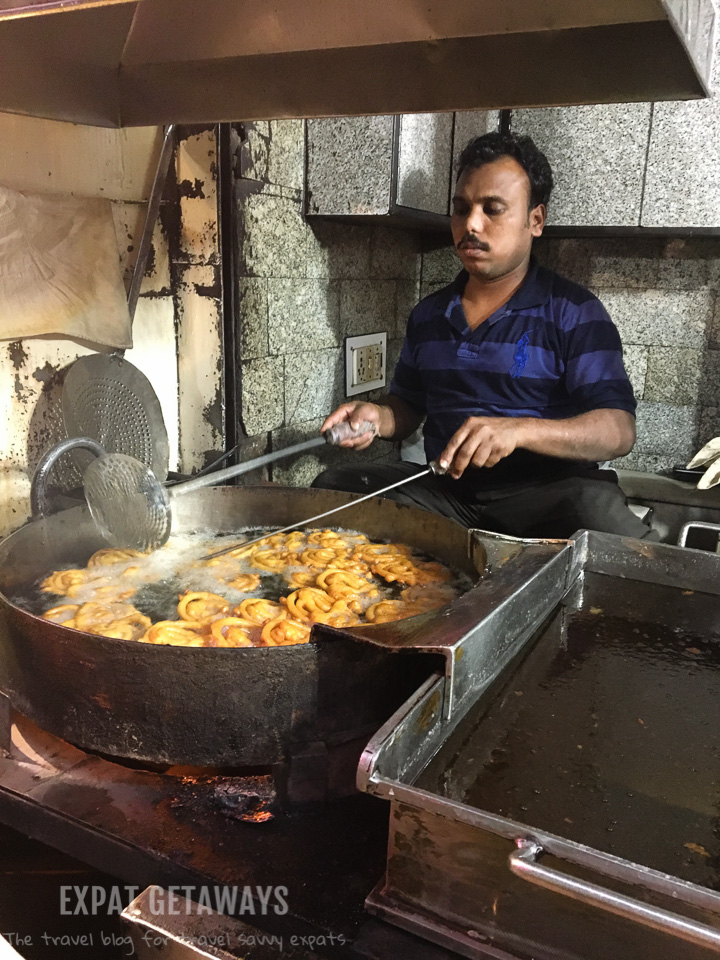 Our guide knew which street vendors he could trust to serve up delicious local food. Expat Getaways, 5 Nights Golden Triangle, Delhi, Jaipur & Agra, India.