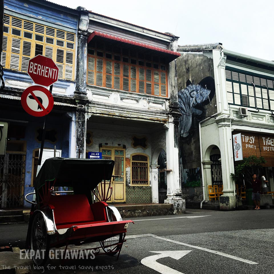 The old and the new in the George Town, Penang. UNESCO listed houses, rickshaws and modern street art.