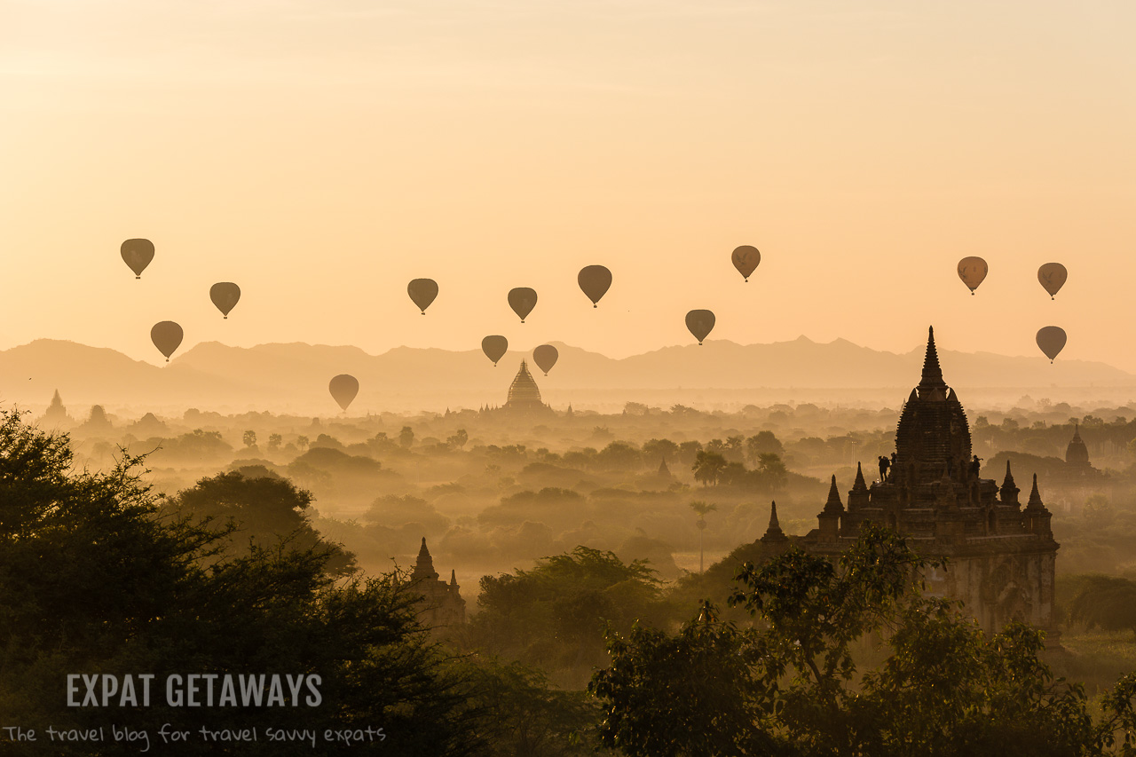 Tourists watch on as 21 balloons float along the Bagan countryside, admiring the temples, stupas and pagodas made centuries ago. Shot in Myanmar. andrewmizziphotography.com Follow my latest updates on Fb.com/andrewmizziphoto | Instagr.am/and.miz