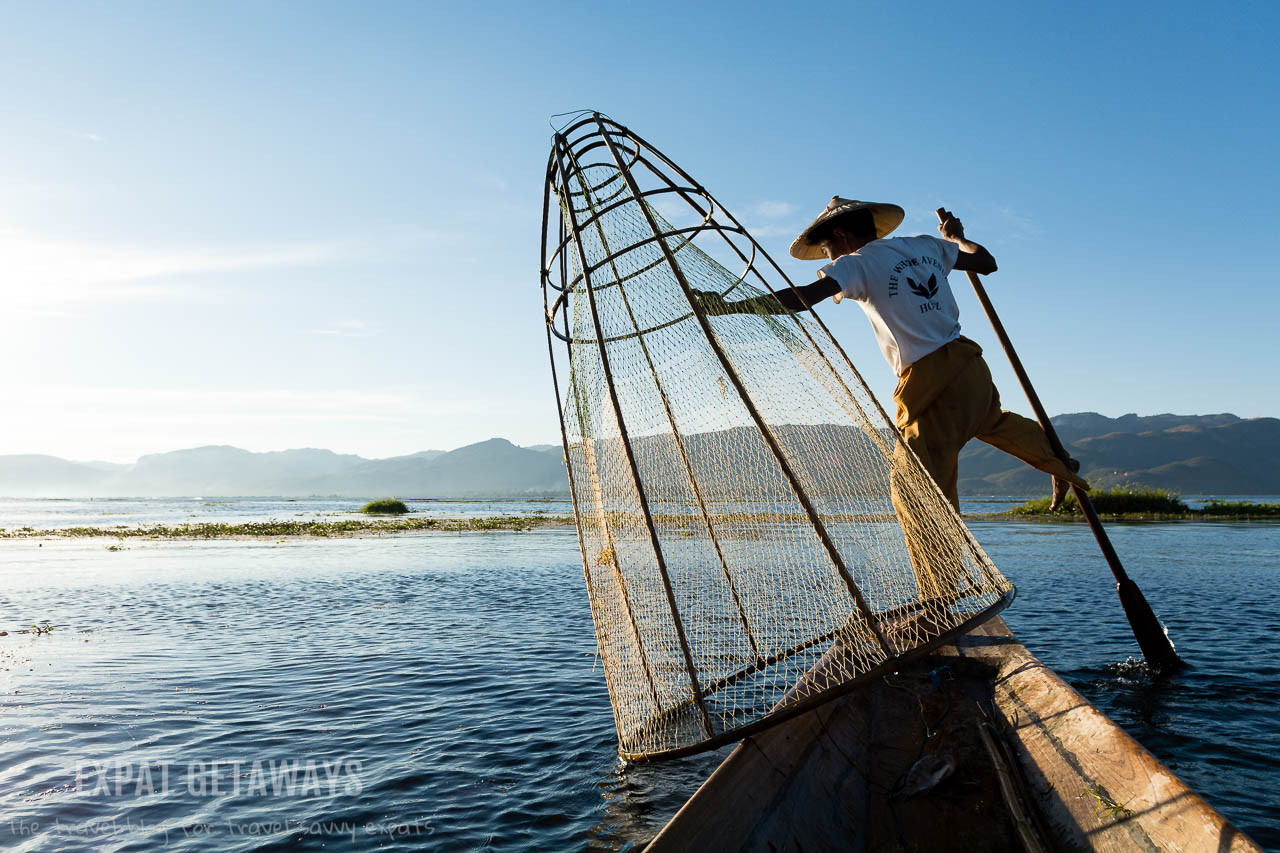 A fisherman on Inle Lake rowing his boat in the traditional style with one foot while searching for fish with his net. Taken on Inle Lake in Myanmar. andrewmizziphotography.com Follow my latest updates on Fb.com/andrewmizziphoto | Instagr.am/and.miz