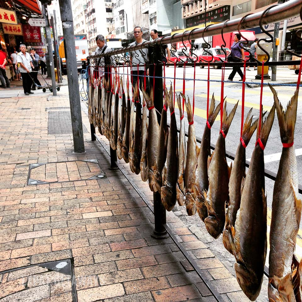 Shop keepers dry their fish along Des Veoux Road West, Sheung Wan. Hong Kong Western District