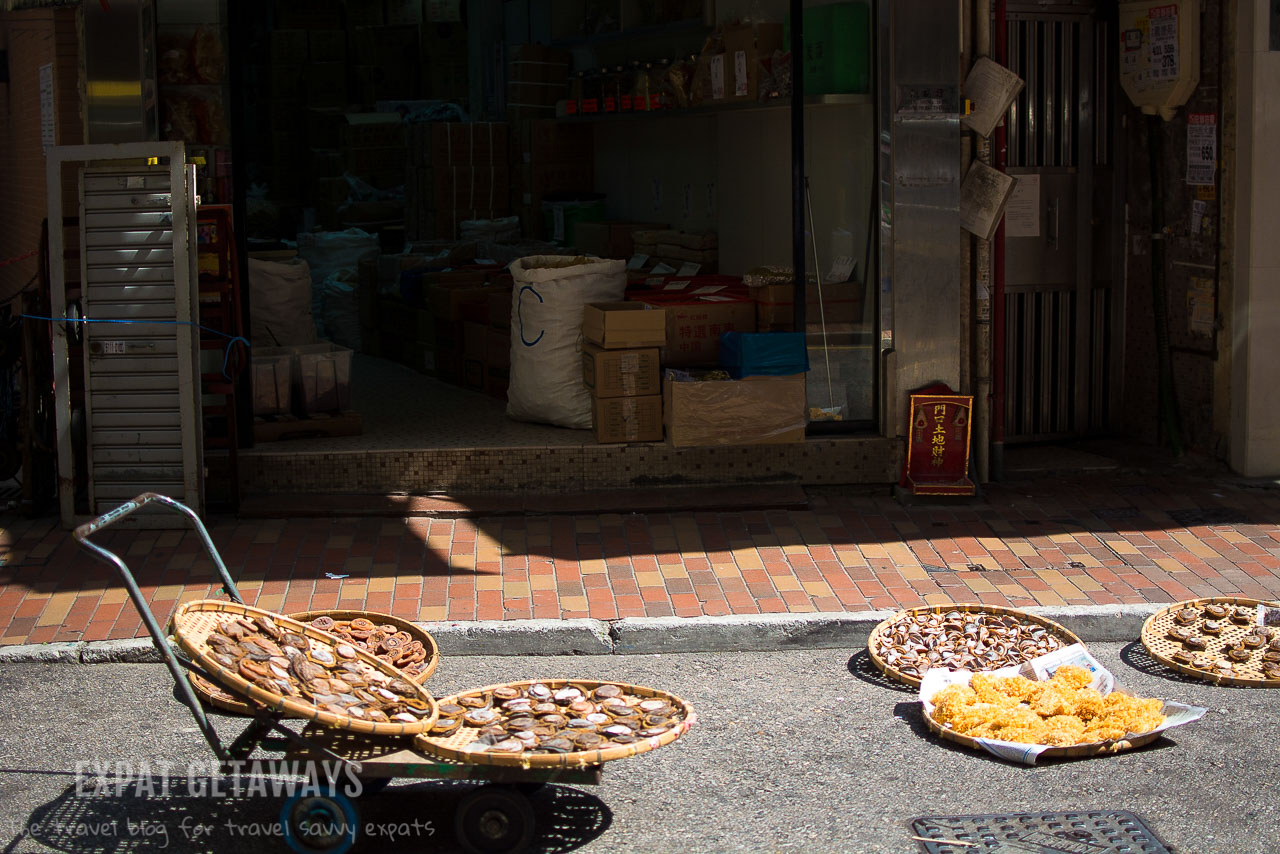 When the sun comes out shop keepers dry seafood in baskets out on the street.