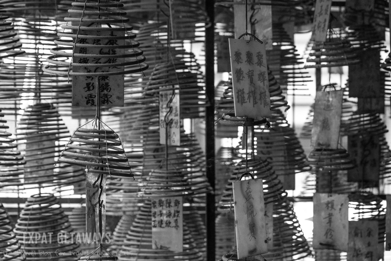 Giant incense coils line the entrance to the Pak Shing Temple. Hong Kong Western District