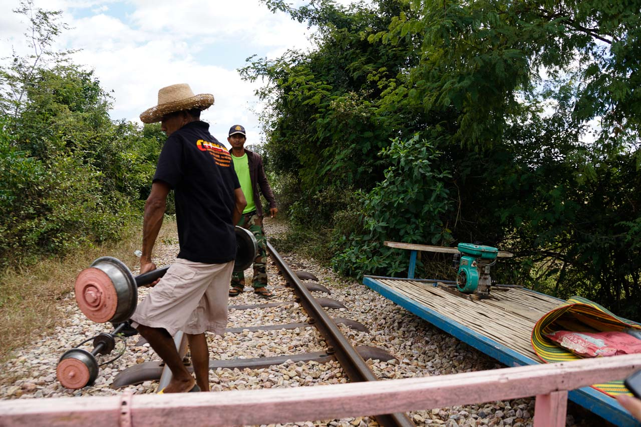 Dismantling the bamboo train so another can pass.