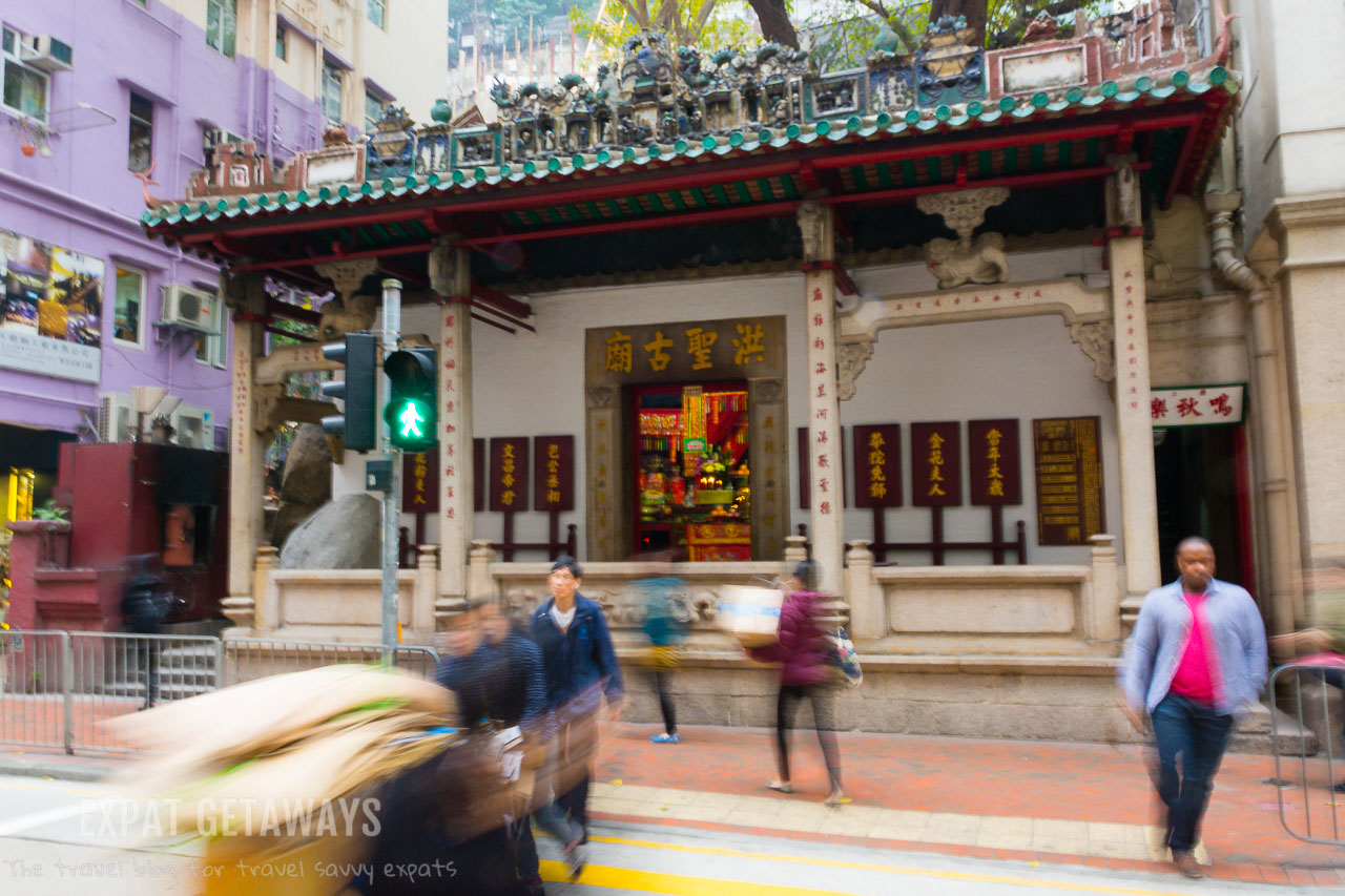 The Hung Shing Temple in Wan Chai is built into the side of a boulder on Queens Road East.