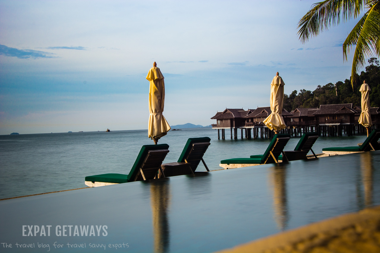 Relaxing by the pool... I think it is going to be a good day in Pangkor Laut Resort, Malaysia.