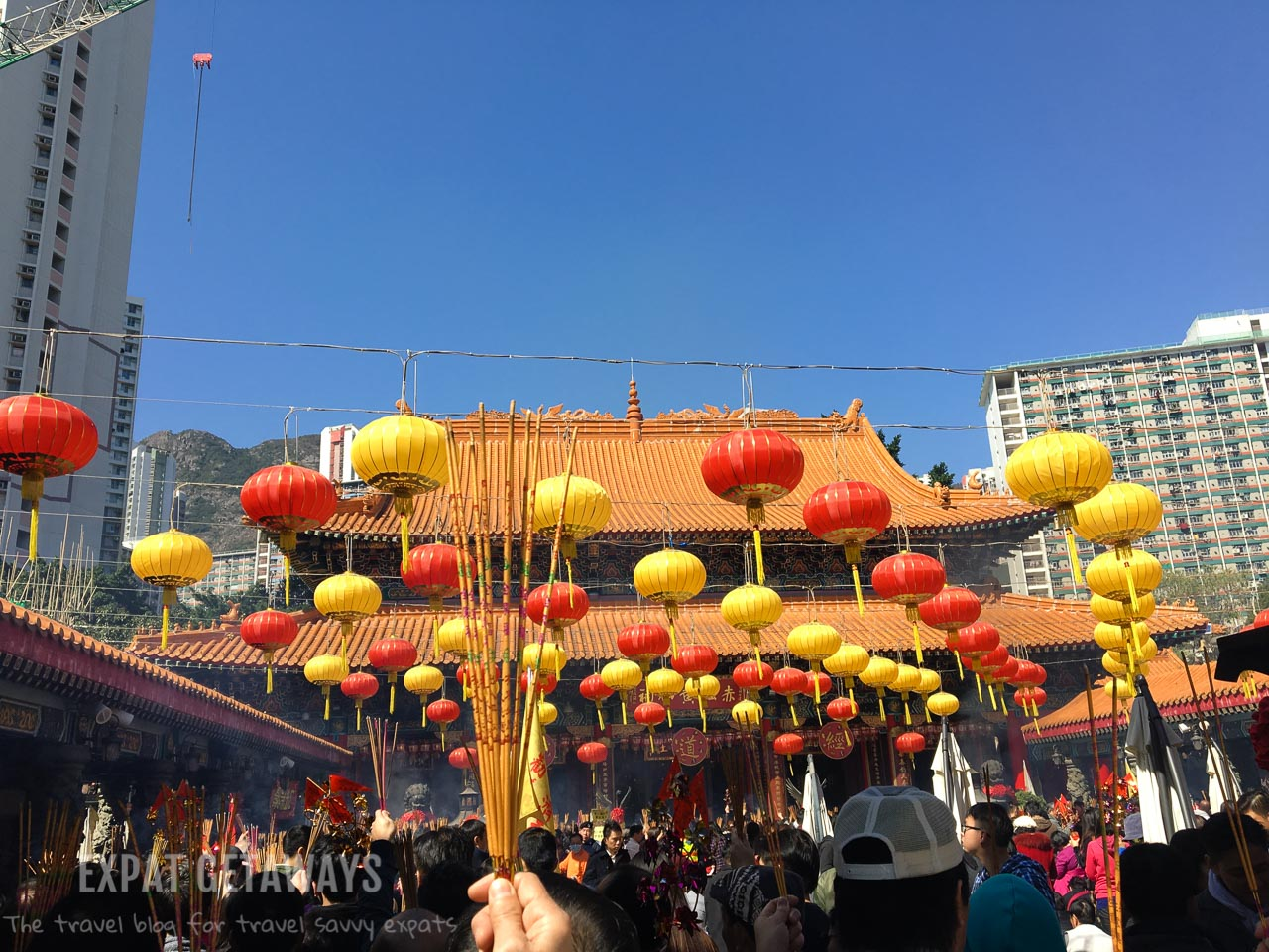 Wong Tai Sin Temple comes alive during Chinese New Year. Worshippers flock here to have their fortunes told and make their wishes for the year ahead.