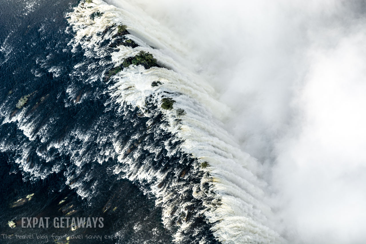 "In the wet season Victoria Falls truly becomes the ""smoke that thunders"". The best view is from a helicopter in Zimbabwe or Zambia. Expat Getaways 2 Weeks in Southern Africa."