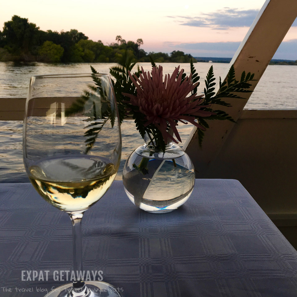 Enjoy a glass of wine while the sunsets over the Zambezi River, Zimbabwe.