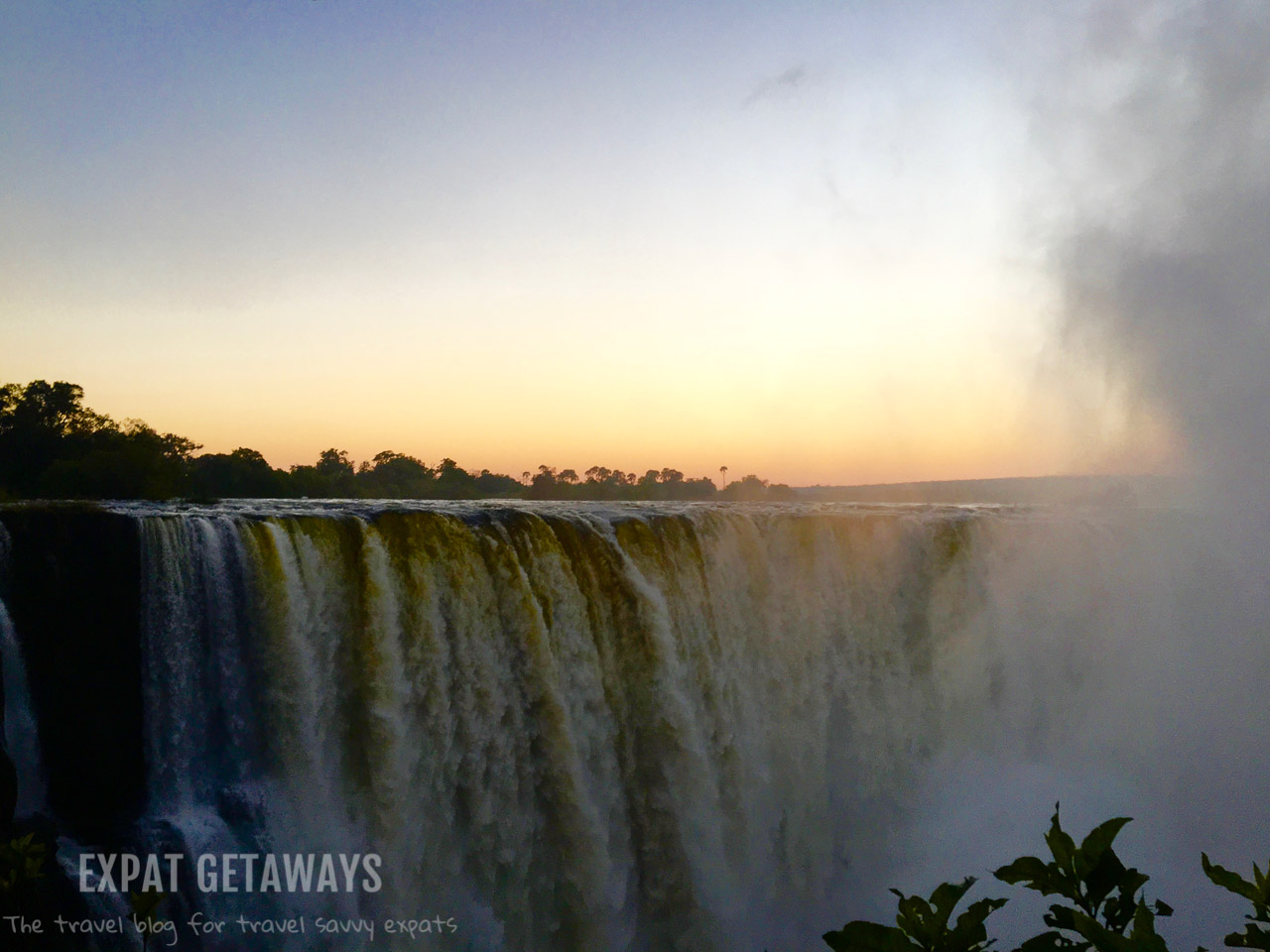 Get up early and get to Victoria Falls at sunrise. Victoria Falls, ZImbabwe.