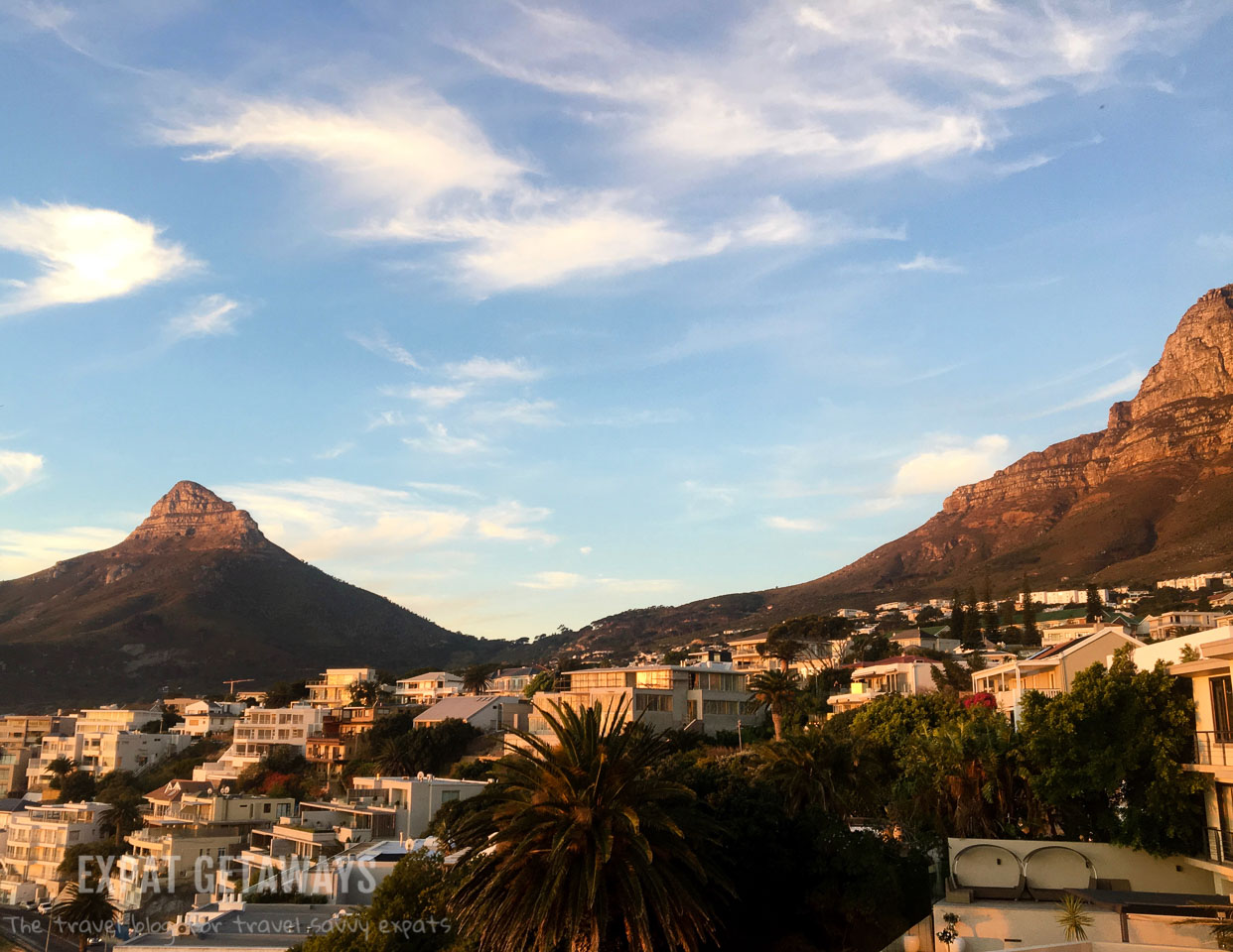 The view from our wonderful apartment in Camps Bay. Ocean views from our balcony and spectacular sunsets with Lions Head as a backdrop. Expat Getaways One Week in Cape Town, South Africa.