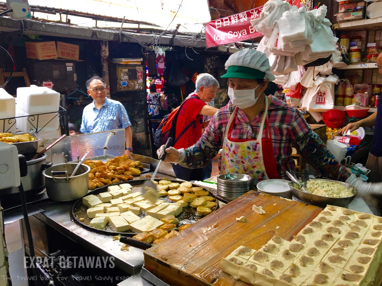 You'll often see workers cooking up a storm. Expat Getaways, First Time Survival Guide - Chinese food.