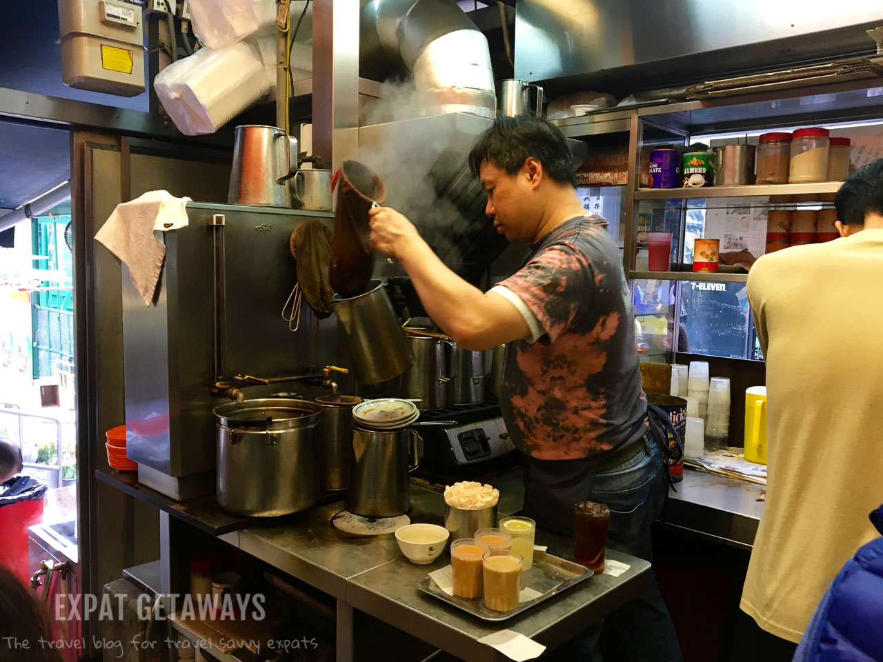 Strong tea is strained through a silk stocking before milk is added to make a Hong Kong style milk tea. Expat Getaways, First Time Hong Kong Survival Guide - Chinese food.
