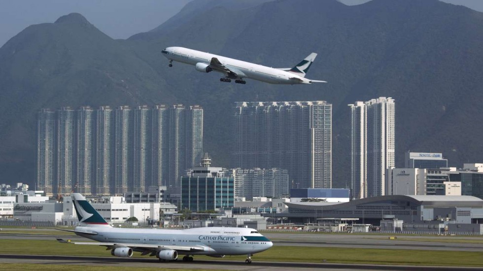 Photo Source: SCMP. Departing plane at Hong Kong International Airport.
