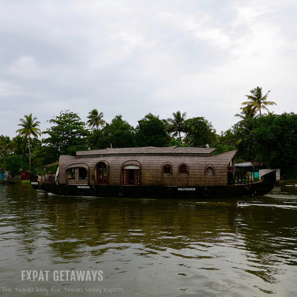 A houseboat cruises along the Kerala Backwaters near Alleppey. Expat Getaways - One Week in Kerala, India.
