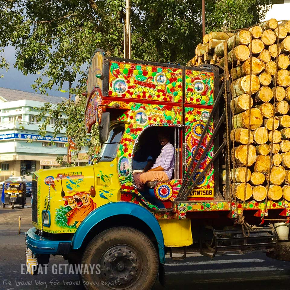 A colourful truck goes by on the streets of Muvattupuzha where Indian Summer House is located. Expat Getaways - One Week in Kerala, India.