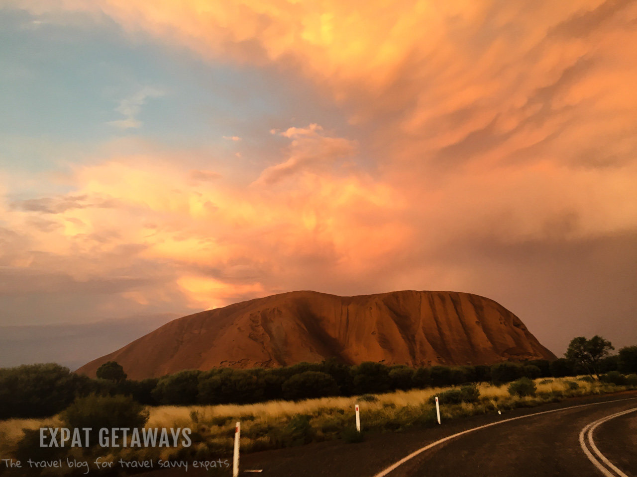 Uluru is amazing at sunset, especially after a storm. Expat Getaways - Babymoon Destinations.