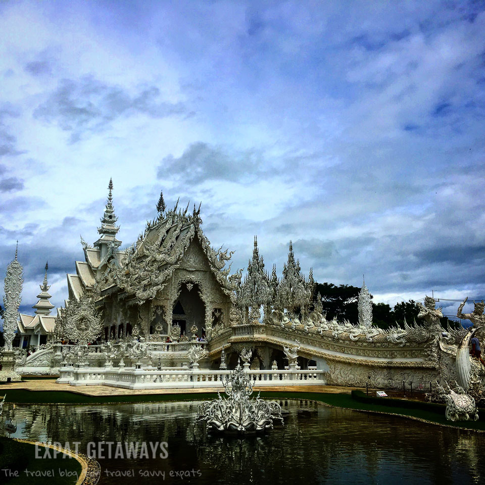 The stunning and slightly odd White Temple in Chiang Rai, Thailand. Expat Getaways - Babymoon Destinations.