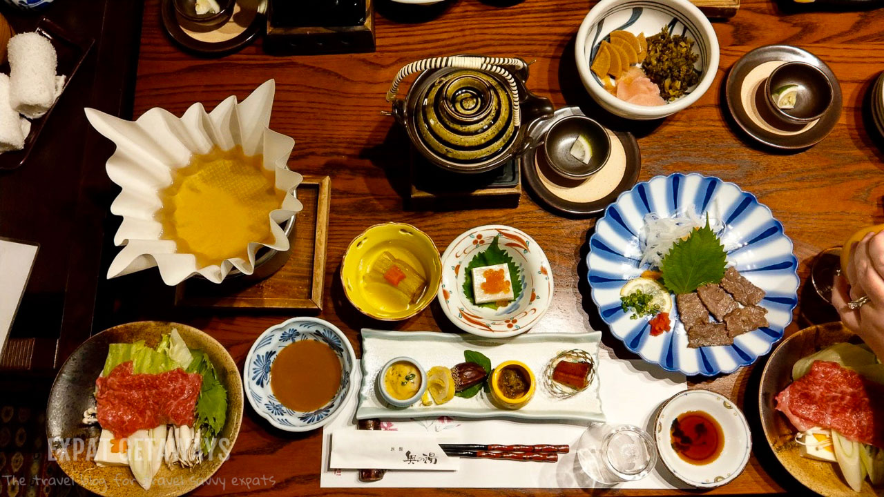 A traditional Japanese dinner at the Kurokawa ryokan. Expat Getaways - Babymoon Destinations.