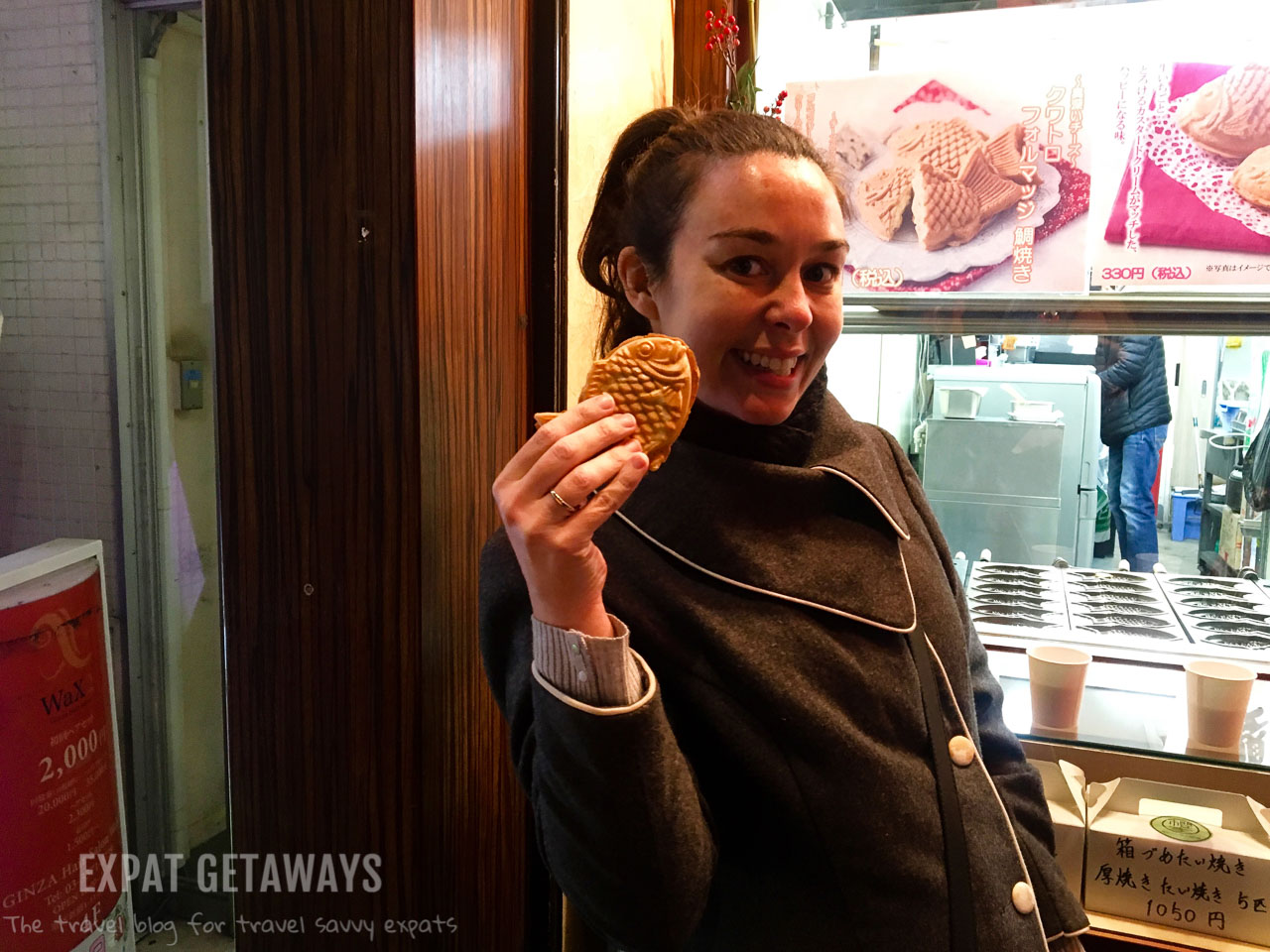 Enjoying dessert on a food tour of Tokyo while 28 weeks pregnant. Expat Getaways - Babymoon Destinations.