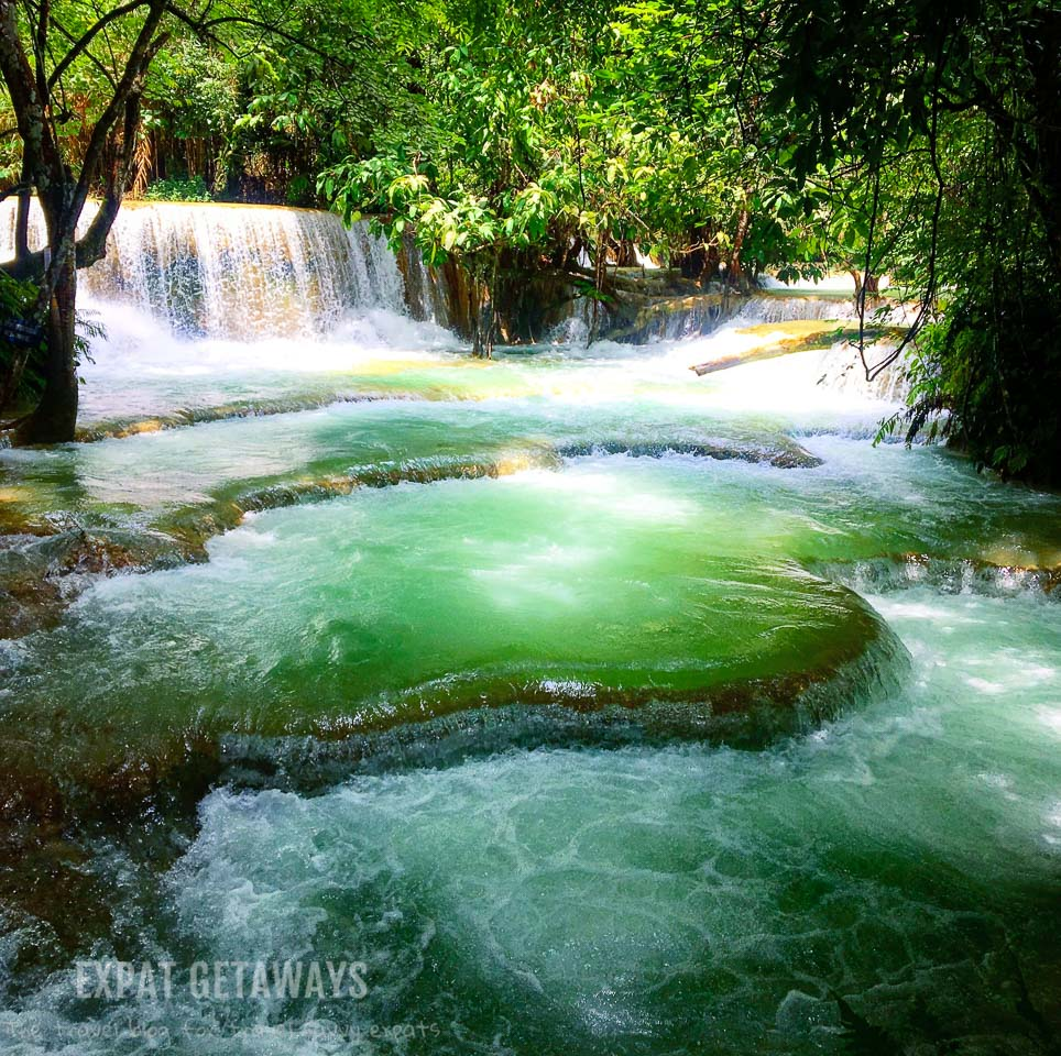 Swim in the turquoise pools of Kuang Si Falls. Luang Prabang, Laos. Expat Getaways, 48 Hours in Luang Prabang, Laos.